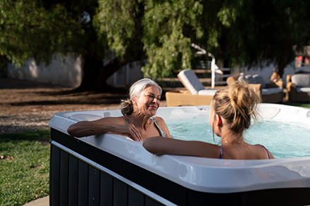caldera-utopia-geneva-2019-arctic-white-brownstone-lifestyle-two-women-in-spa-01